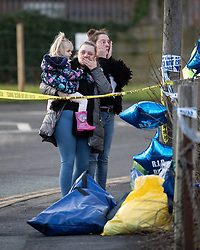 © Licensed to London News Pictures . 29/12/2018 . Wigan , UK . People leave tributes at the scene where police have taped off a stretch of Bickershaw Lane in Abram . GMP report they have arrested two people on suspicion of attempted murder and for conspiracy to commit attempted murder , respectively , after a 21-year-old man , identified locally as Billy Livesley , sustained life-threatening injuries yesterday evening (Friday 28th December 2018) . Photo credit : Joel Goodman/LNP