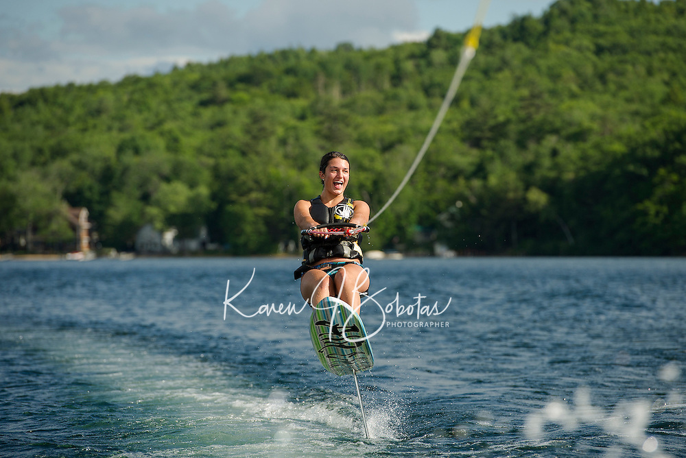 Julia Cantin takes a spin on an Air Chair on Lake Winnisquam.  (Karen Bobotas/for the Laconia Daily Sun)