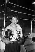 25/01/1963<br /> 01/25/1963<br /> 25 January 1963<br /> National Junior Boxing Championships at the National Stadium, Dublin. Picture shows S. McCafferty of the St. John Bosco Boxing Club, Belfast, the National Junior Flyweight Champion of Ireland 1963 with his trophy after he beat G. Deegan of St. Matthews, Belfast at the National Boxing Stadium.