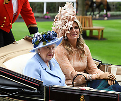 Queen Elizabeth II (left) and Queen Maxima of The Netherlands arriving by carriage during day one of Royal Ascot at Ascot Racecourse.