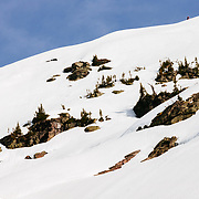 Lynsey Dyer skis an ice encrusted line off of the backside of Gunsight Peak in Glacier National park.