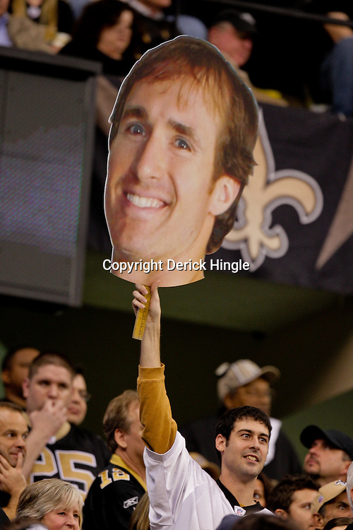 2009 November 30: A New Orleans Saints fan holds up a large sign with the head of quarterback Drew Brees during a 38-17 win by the New Orleans Saints over the New England Patriots at the Louisiana Superdome in New Orleans, Louisiana.