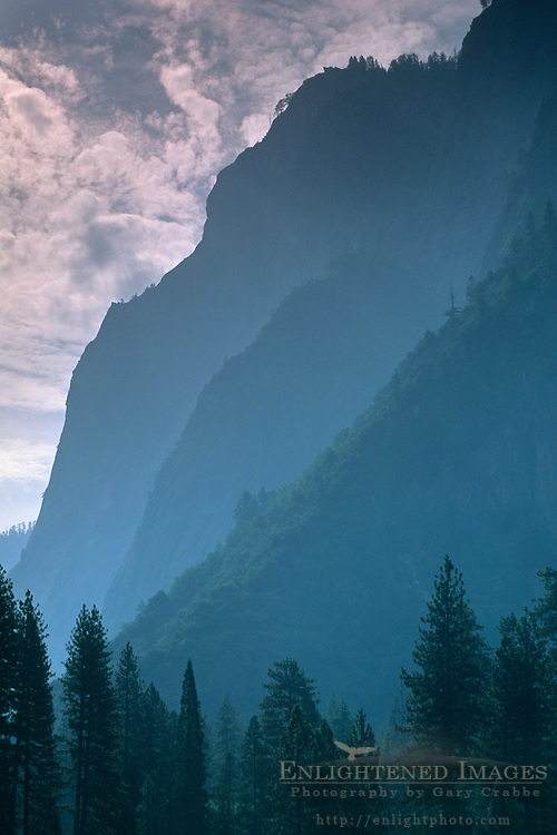 Hazy sky over steep cliffs below Glacier Point, Yosemite Valley, Yosemite National Park, California