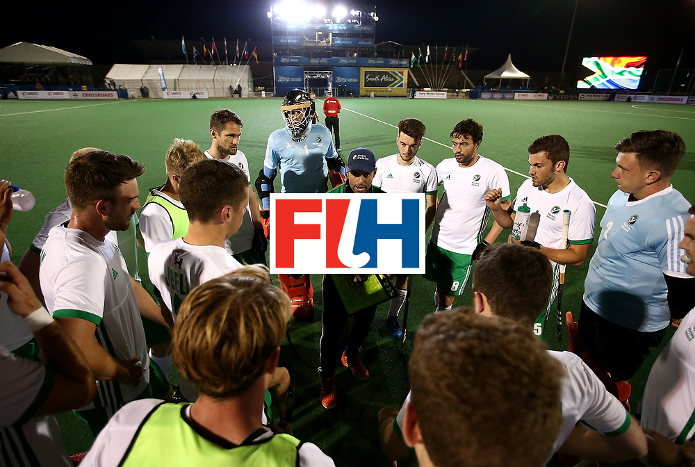 JOHANNESBURG, SOUTH AFRICA - JULY 09:  Ireland head coach Craig Fulton chats to his players during day 1 of the FIH Hockey World League Semi Finals Pool B match between South Africa and Ireland at Wits University on July 9, 2017 in Johannesburg, South Africa.  (Photo by Jan Kruger/Getty Images for FIH)