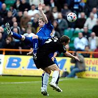 Photo: Ed Godden.<br />Barnet v Stockport County. Coca Cola League 2. 29/04/2006. Adam Griffin climbs high onto Barnet's Liam Hatch (R).
