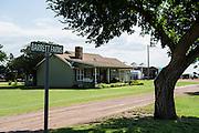 John Barrett lives in this farmhouse where he was born near Martha, Oklahoma.