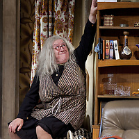 Gregor Fisher as 'Yer Granny' eating the family out of house and home.<br /> <br /> Yer Granny - a new production by The National Theatre of Scotland opens at the Beacon arts Centre, Greenock, Scotland.<br /> <br /> <br /> Based on La Nona by Roberto Cossa<br /> In a new version by Douglas Maxwell<br /> Directed by Graham McLaren<br /> <br /> <br /> Picture by Drew Farrell<br /> Tel : 07721-735041<br /> Image offered on a speculative basis.<br /> <br /> Yer Granny is a riotous new comedy about a diabolical 100-year-old granny who&rsquo;s literally eating her family out of house and home. She&rsquo;s already eaten their fish and chip shop into bankruptcy and now she&rsquo;s working her way through their kitchen cupboards, pushing the Russo family to desperate measures just to survive beyond 1977.<br /> <br /> As proud head of the family, Cammy is determined that The Minerva Fish Bar will rise again and that family honour will be restored &ndash; and all in time for the Queen&rsquo;s upcoming Jubilee visit. But before Cammy&rsquo;s dream can come true and before Her Maj can pop in for a chat, a single sausage and a royal seal of approval, the family members must ask themselves how far they will go to solve a problem like Yer Granny.<br /> <br /> Adapted from the smash-hit Argentinian comedy classic La Nona, the cast of Yer Granny features some of Scotland&rsquo;s best-loved performers, including Gregor Fisher in the title role, alongside Paul Riley (Still Game), Jonathan Watson (Only An Excuse?), Maureen Beattie (Casualty), Barbara Rafferty (Rab C Nesbitt), Brian Pettifer (The Musketeers) and Louise McCarthy (Mamma Mia!, West End).<br /> <br /> Performance dates :<br /> The Beacon Arts Centre, Greenock<br /> 19/05/2015&nbsp;-&nbsp;21/05/2015 <br /> <br /> King's Theatre, Glasgow<br /> 26/05/2015&nbsp;-&nbsp;30/05/2015 <br /> <br /> King's Theatre, Edinburgh<br /> 02/06/2015&nbsp;-&nbsp;06/06/2015 <br /> <br /> Eden Court, Inverness<br /> <br /> Lyric Theatre, Belfast<br /> 23/06/2015&nbsp;-&nbsp;27/06/2015 <br /> <br /> Dundee Rep Theatre<br /> 30/06/2015&nbsp;-&nbsp;04/07/2015