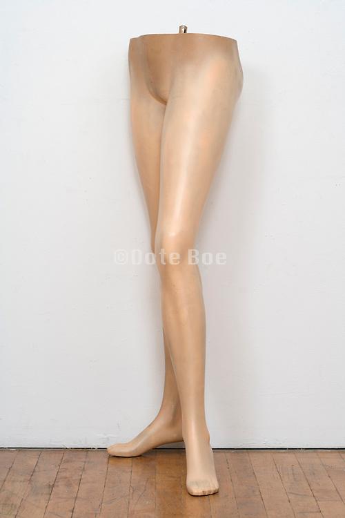 mannequin legs against a white wall
