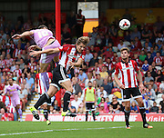 (Carlos) Orlando Sa (Reading striker) rising above James Tarkowski (Brentford defender) to score the first goal during the Sky Bet Championship match between Brentford and Reading at Griffin Park, London, England on 29 August 2015. Photo by Matthew Redman.