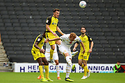 Burton Albion defender Kieran Wallace heads the ball during the EFL Sky Bet League 1 match between Milton Keynes Dons and Burton Albion at stadium:mk, Milton Keynes, England on 5 October 2019.