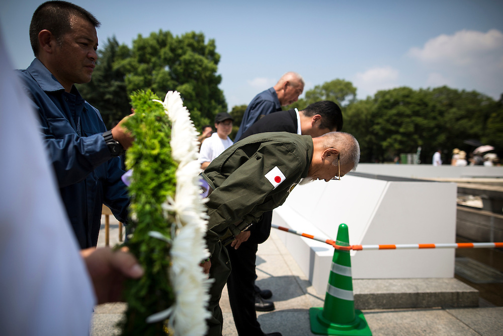 "HIROSHIMA, JAPAN - AUGUST 5 : A group of Japanese nationalists and militarists lays wreath and paid their respects to the victims of the Hiroshima bombing in front of the cenotaph ahead of the 71st anniversary of the atomic bombing on Hiroshima at Hiroshima Peace Memorial Park in Hiroshima, western Japan, Friday, August 5, 2016. Japan marked the 71st anniversary of the atomic bombing on Hiroshima. On August 6, 1945, during World War II, the United States dropped a uranium gun-type atomic bomb named ""Little Boy"" on the city of Hiroshima which instantly killed an estimated 80,000 people, tens of thousands more would later die of radiation exposure. Three days later, a second American B-29 bomber dropped a plutonium implosion-type bomb ""Fat Man"" on Nagasaki, killing an estimated 40,000 people. (Photo: Richard Atrero de Guzman/NURPhoto)"