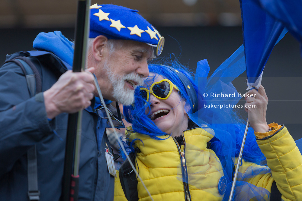 Elderly and young pro-EU Brexit protestors opposite parliament on College Greeen in Westminster, the morning after another of Prime Minister Theresa May's Brexit deal votes failed again in Parliament, on 13th March 2019, in London, England.