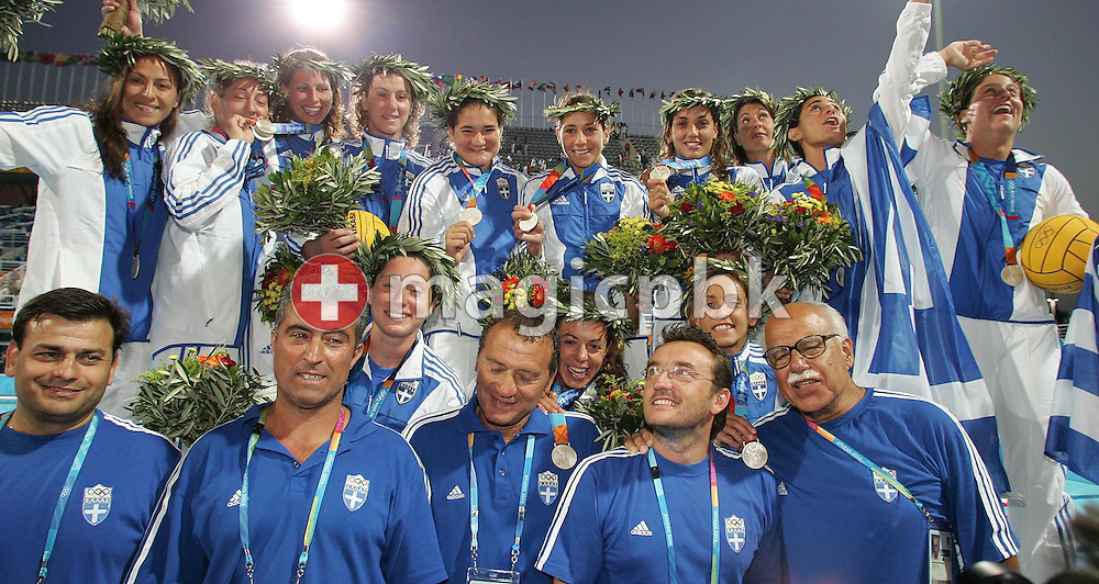 The Greek women's water polo team poses with their silver medals losing to Italy in the Women's Water Polo final at the Olympic Aquatic Centre in Athens Thursday 26 August 2004.  Italy won the gold medal in a close 10-9 match. (Photo by Patrick B. Kraemer / MAGICPBK)