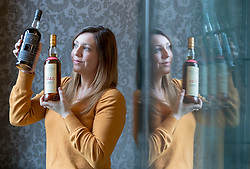 Auction house, Bonham's, will be holding a sale of rare whisky on 7 March 2018 at 11am. <br /> <br /> The sale includes two rare whiskies; a bottle of the Macallan Select Reserve 52 year-old 1946, bottled in May 1998. It is estimated at £12,000-14,000 and a bottle of Black Bowmore 1964, bottled in 1994, and estimated at £8,000-10,000. <br /> <br /> The 1946 Macallan was produced in an unusual way. Coal was scarce and expensive immediate after World War II, so the malt was dried in peat-fired kilns instead resulting in a whisky with distinct and complex tastes and aromas.<br /> <br /> Pictured: Bethan Koller of Bonhams with the Macallan 1946 and the Black Bowmore 1964