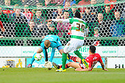 Yeovil Town's Francois Zoko gets a shot away which is saved by Exeter City's Robert Olejnik during the Sky Bet League 2 match between Yeovil Town and Exeter City at Huish Park, Yeovil, England on 9 April 2016. Photo by Graham Hunt.