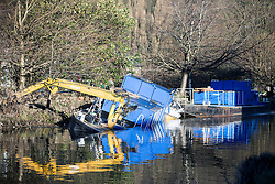 © Licensed to London News Pictures. 29/12/2015. Elland UK. Picture shows a sunken barge on the Calder & Hebble Navigation at Greenway in Elland after recent flooding.  Photo credit: Andrew McCaren/LNP
