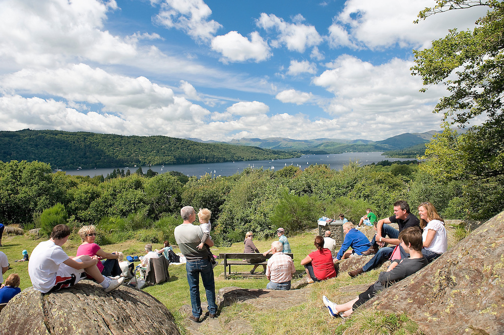 Lake District National Park, Cumbria, England, UK. Tourists at popular viewpoint of Biskey Howe overlooking Windermere. Summer