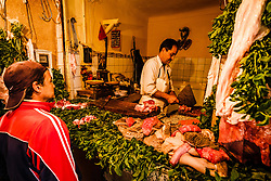 A butcher serving a customer from his stall in the medina in Marrakech, North Africa<br /> <br /> (c) Andrew Wilson | Edinburgh Elite media