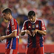 Claudio Pizarro, (right),  FC Bayern Munich, discusses positioning with Robert Lewandowski, FC Bayern Munich, during the FC Bayern Munich vs Chivas Guadalajara, Audi Football Summit match at Red Bull Arena, New Jersey, USA. 31st July 2014. Photo Tim Clayton