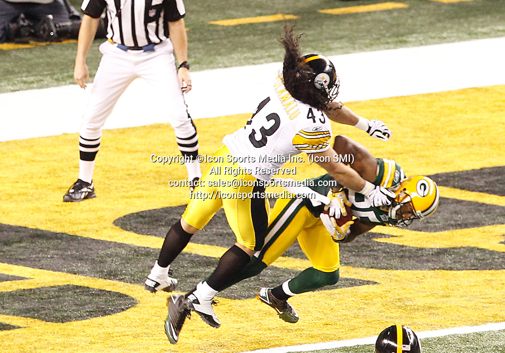 February 6, 2011:  Green Bay Packers WR Greg Jennings #85 catches a pass for a touchdown and maintains possession while being hit by Pittsburgh Steelers SS Troy Polamalu #43 during the second quarter of the Pittsburgh Steelers game versus the Green Bay Packers in Super Bowl XLV at Cowboys Stadium in Arlington, Texas.***FOR EDITORIAL USE ONLY****