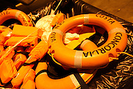 Life jackets from the Costa Concordia cruise ship on the dock of Giglio harbour
