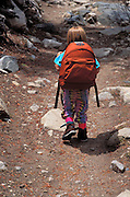 Child (age 4) with pack hiking on the Morgan Pass Trail, John Muir Wilderness, California