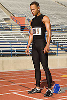 Male track athlete standing on track
