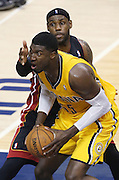 Pacer Roy Hibbert works under the basket under pressure from the Heat's LeBron James during the second quarter. The Indiana Pacers hosted the Miami Heat in game two of the Eastern Conference Finals at Bankers Life Fieldhouse Tuesday, May 20, 2014.