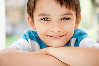 Young boy outside portrait close up