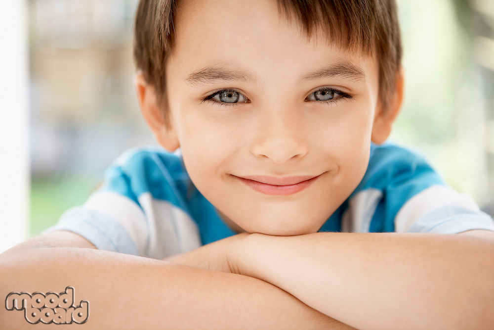 Young boy outside portrait close up