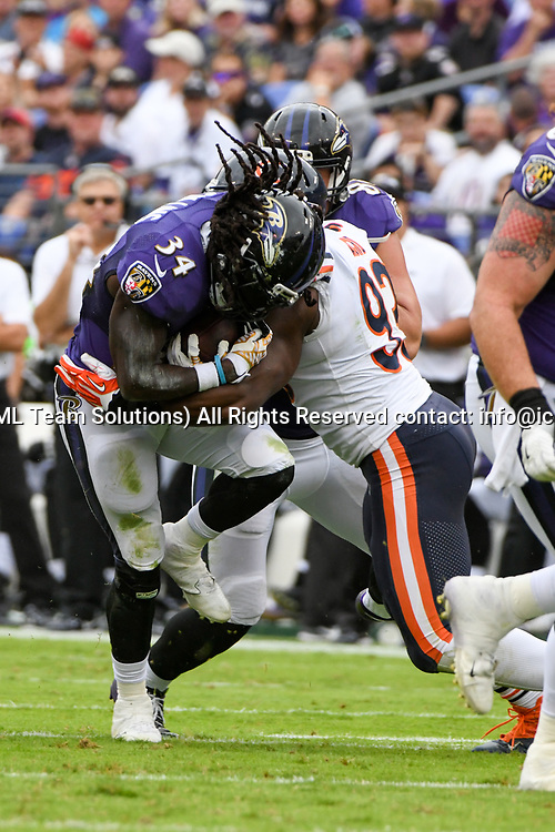 BALTIMORE, MD - OCTOBER 15: Baltimore Ravens running back Alex Collins (34) is brought down by Chicago Bears outside linebacker Sam Acho (93) on October 15, 2017, at M&T Bank Stadium in Baltimore, MD.  (Photo by Mark Goldman/Icon Sportswire)