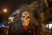 New York, NY, October 31, 2013. A very grim reaper  in the Greenwich Village Halloween Parade.