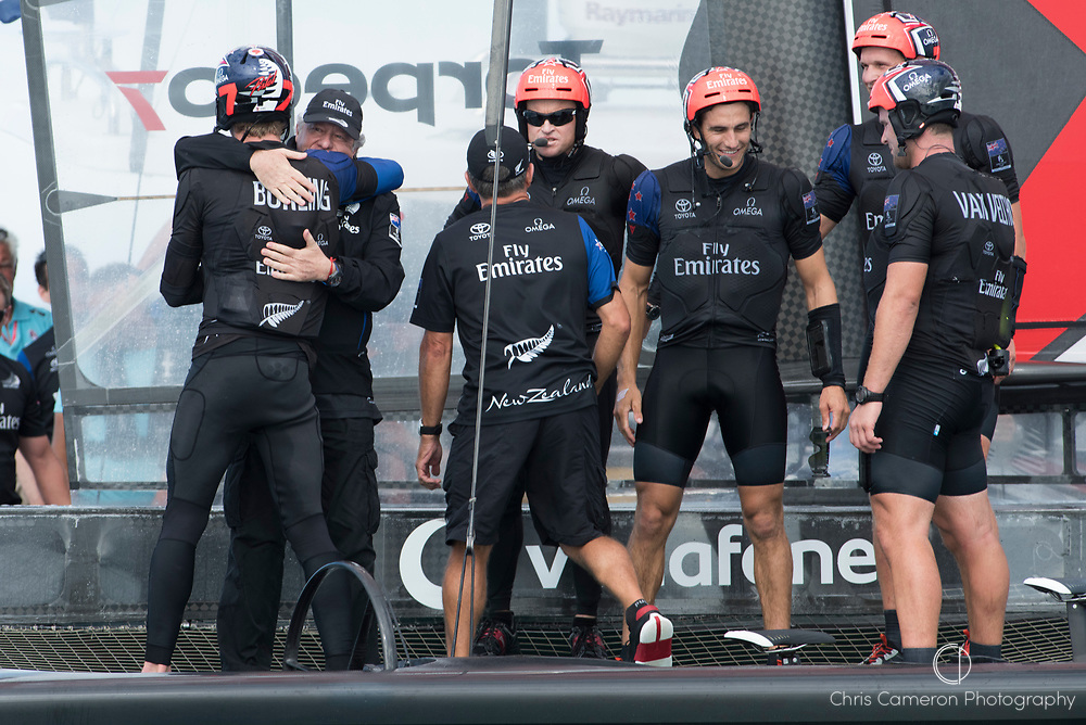 The Great Sound, Bermuda 12th June 2017. Emirates Team New Zealand Principal Matteo DeNora gives Peter Burling a hug after the Team win the Louis Vuitton America's Cup Challenger series.