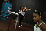 Youths perform during their ballet class at the 'Ballet Santa Teresa' academy in Rio de Janeiro August 13, 2012. 'Ballet Santa Teresa', a non-governmental organization (NGO) gives children who live in areas with social risk, some suffering domestic violence, free ballet classes and other activities as a part of socio-cultural integration project. Photo by: Pilar Olivares