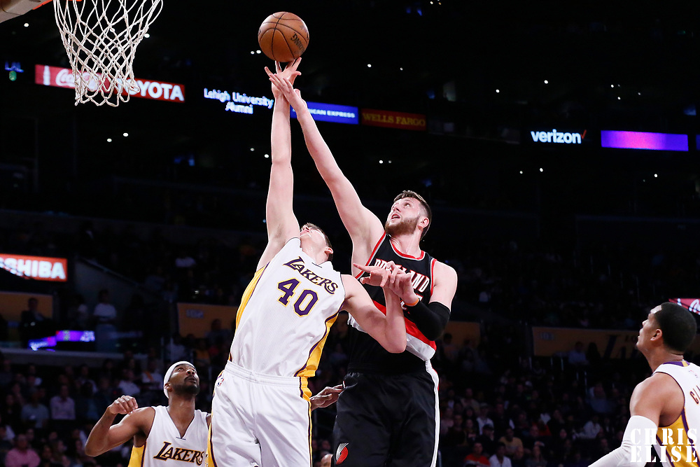 26 March 2016: Los Angeles Lakers center Ivica Zubac (40) reaches for the ball against Portland Trail Blazers center Jusuf Nurkic (27) during the Portland Trail Blazers 97-81 victory over the Los Angeles Lakers, at the Staples Center, Los Angeles, California, USA.