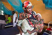 A mother and baby who have just been discharged  by Dr Siobhan during the morning ward round. St Walburg's Hospital, Nyangao. Lindi Region, Tanzania.