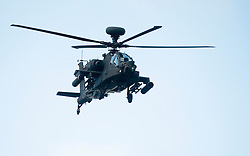 4 Mech Bde taking part in the Mission Specific Training on Salisbury Plain Training Area. A British Army Apache Helicopter provides the MERT (medical Emergency Response Team) with air cover  9 Feb 2010