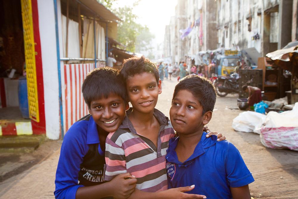Children pose for a picture in a slum in Chennai, India.