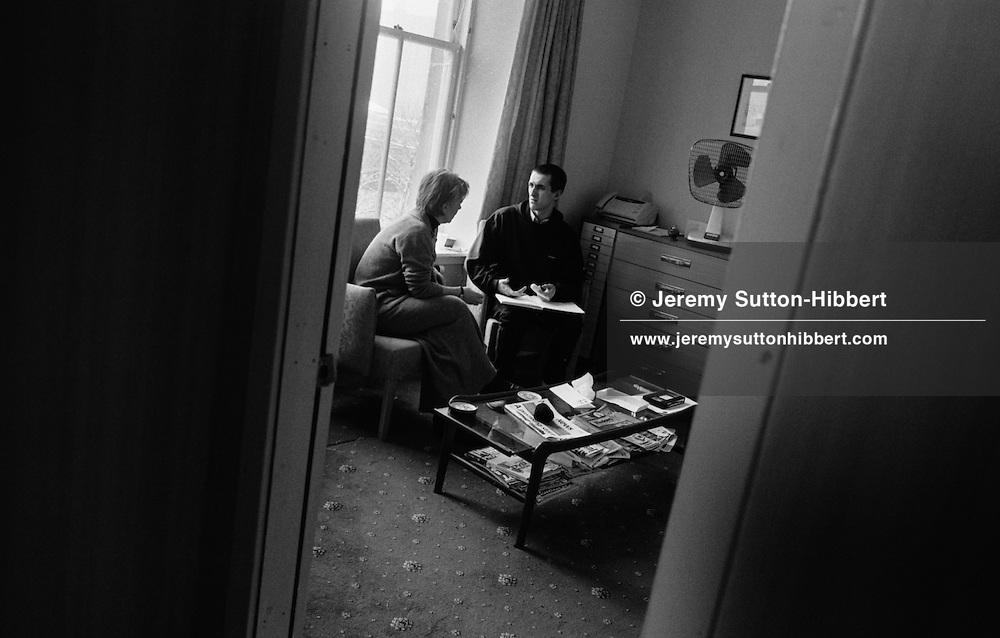 DURING A DIARY SESSION JANET LEINO, ON LEFT,  OF THE SALVATION ARMY TALKS WITH SCOTT WALKER, A DRUG ADDICT UNDERGOING REHABILITATION AT THE SALVATION ARMY ADDICTION REHAB UNIT, HOPE HOUSE, CLYDE STREET, GLASGOW. FEBRUARY 2001.