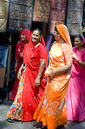 Women dressed in colourful saris in Udaipur, Rajasthan, India
