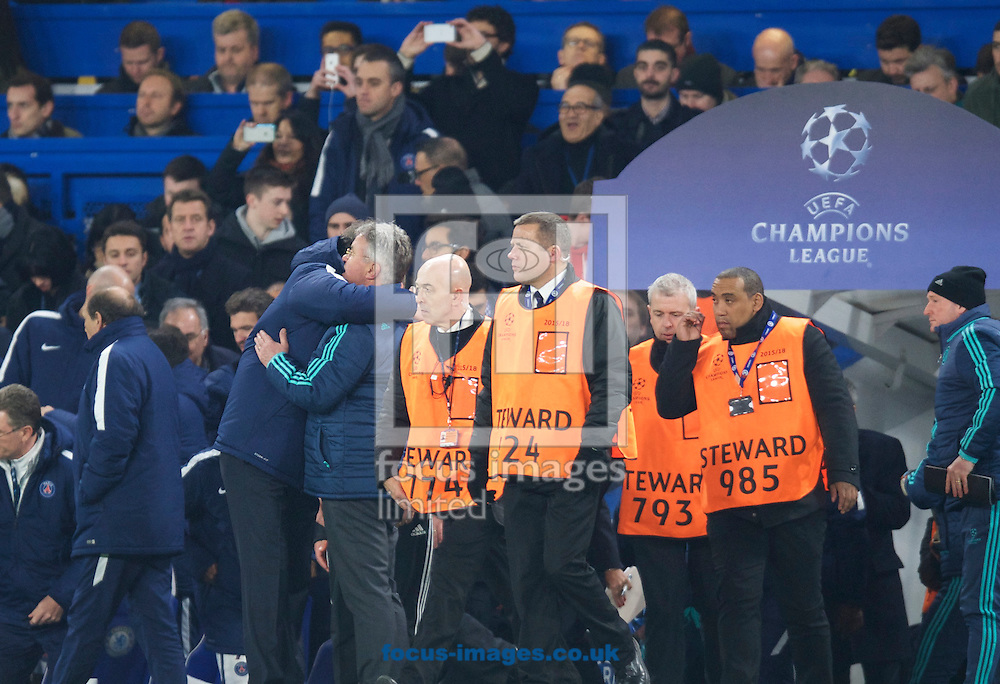 Manager Laurent Blanc of Paris Saint-Germain (left) embraces Manager Guus Hiddink of Chelsea after their win in the UEFA Champions League match at Stamford Bridge, London<br /> Picture by Alan Stanford/Focus Images Ltd +44 7915 056117<br /> 09/03/2016