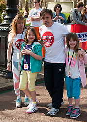 Richard Hammond and his family taking part in a one mile run for Sport Relief charity in London, 25th March 2012.  Photo by: i-Images