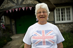 LOCATION, UK  29/04/2011. The Royal Wedding of HRH Prince William to Kate Middleton. ..Mrs Daphne Ince from 'The Old Workshop' cottage in the Woodfords in Wiltshire gets into the spirit of the occasion as she celebrates the Royal Wedding.....Photo credit should read Ian Forsyth/LNP. Please see special instructions. © under license to London News Pictures