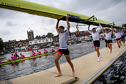 © Licensed to London News Pictures. 28/06/2017. London, UK. Rowers leave the water on Day one of the Henley Royal Regatta, set on the River Thames by the town of Henley-on-Thames in England.  Established in 1839, the five day international rowing event, raced over a course of 2,112 meters (1 mile 550 yards), is considered an important part of the English social season. Photo credit: Ben Cawthra/LNP
