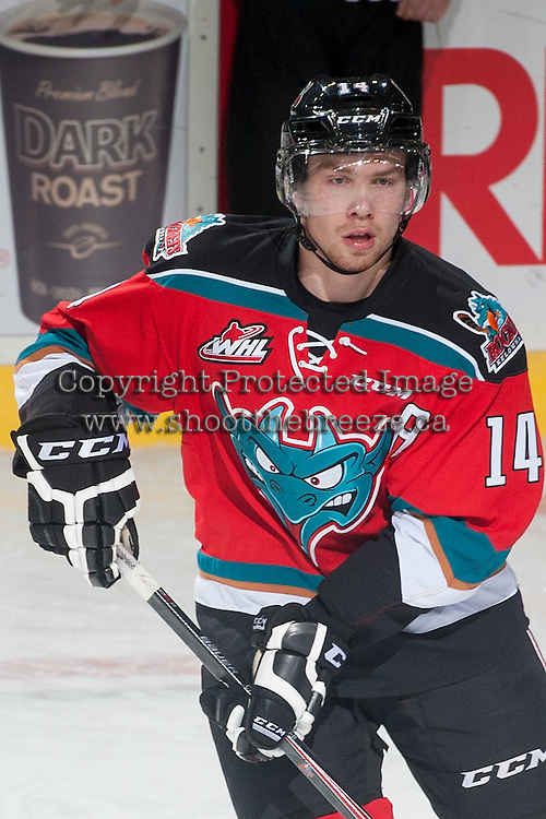 KELOWNA, CANADA - NOVEMBER 7: Rourke Chartier #14 of Kelowna Rockets skates during warm up against the Spokane Chiefs on November 7, 2014 at Prospera Place in Kelowna, British Columbia, Canada.  (Photo by Marissa Baecker/Shoot the Breeze)  *** Local Caption *** Rourke Chartier;