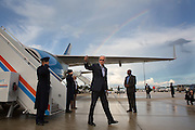 Vice President Joe Biden arrives at Southwest Florida International Airport aboard Air Force 2 and gives a thumbs up as he walks to his car with a rainbow in the background, September 28, 2012. (Official White House Photo by David Lienemann)