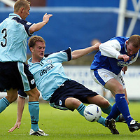 Queen of the South v St Johnstone.. 17.08.02<br />Ian Maxwell takes the ball from Peter Weatherson<br /><br />Pic by Graeme Hart<br />Copyright Perthshire Picture Agency<br />Tel: 01738 623350 / 07990 594431