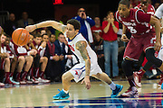 DALLAS, TX - FEBRUARY 19: Nic Moore #11 of the SMU Mustangs comes up with a steal against the Temple Owls on February 19, 2015 at Moody Coliseum in Dallas, Texas.  (Photo by Cooper Neill/Getty Images) *** Local Caption *** Nic Moore