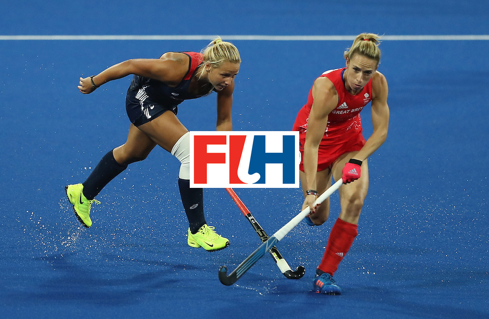 RIO DE JANEIRO, BRAZIL - AUGUST 13:  Susannah Townsend (R) of Great Britain moves away from Kelsey Kolojejchick during the Women's group B hockey match between Great Britain and the USA on Day 8 of the Rio 2016 Olympic Games at the Olympic Hockey Centre on August 13, 2016 in Rio de Janeiro, Brazil.  (Photo by David Rogers/Getty Images)