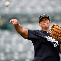 New York Yankees Third Baseman Alex Rodriguez warms up before a rehab minor league game for the AA Trenton Thunder in Trenton, NJ on August 2, 2013.  He is facing a suspension by Major League Baseball for his use of steroids with the Biogenesis clinic in Florida.